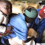 woman-and-baby-receive-maize