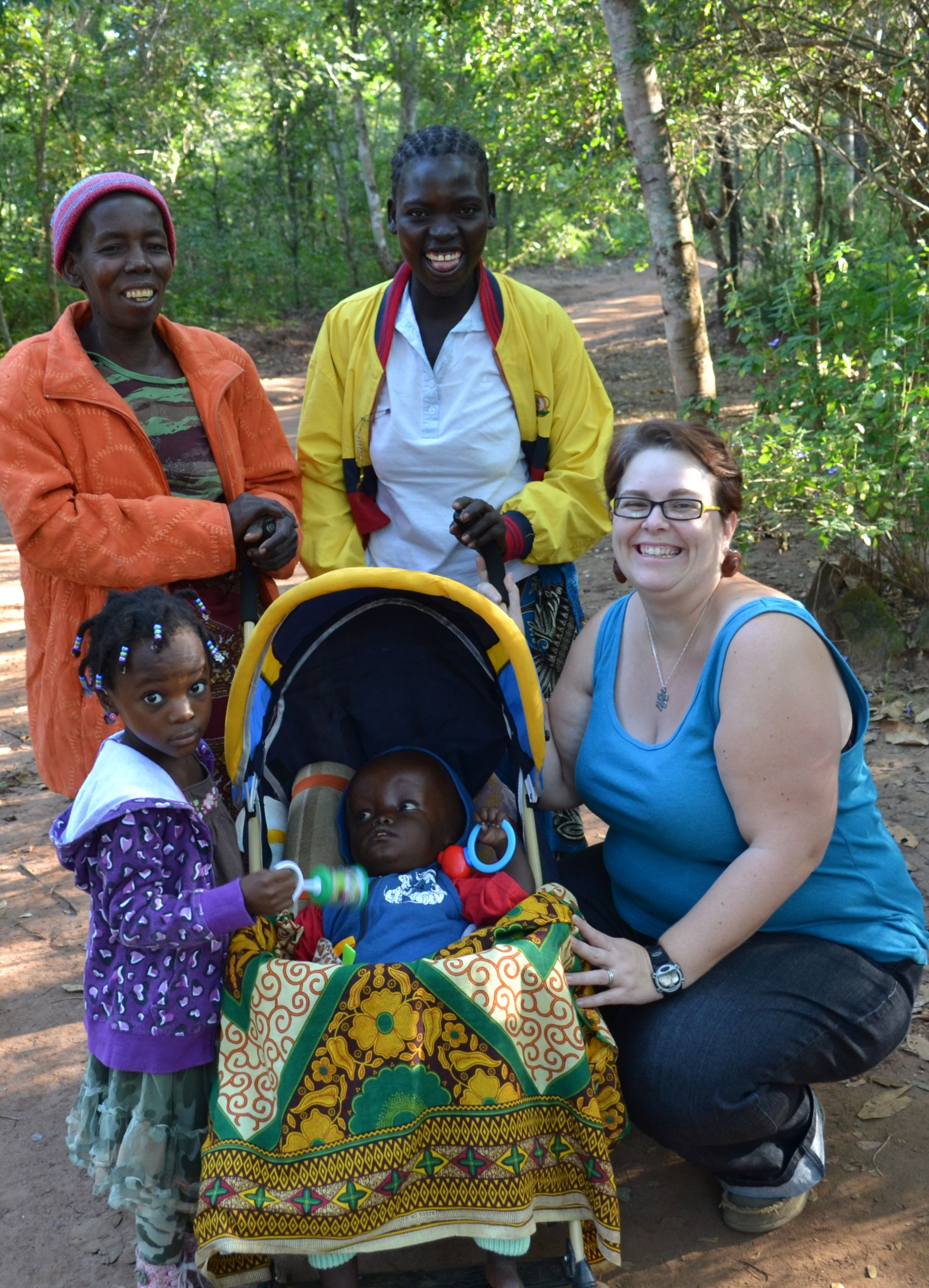 Malachi, His granny, and mom with Heather and Tendai.