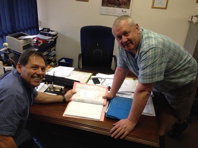 Dwight and Phillip discussing bridge plans