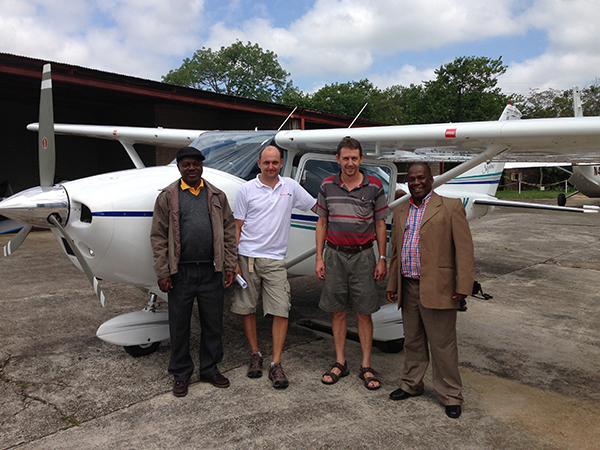 Mozambique Inspectors Paulo and Alfredo with Holger Zeissler and John Herbert of Mercy Air