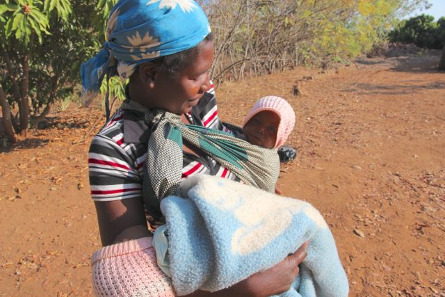 Mozambique woman with twins