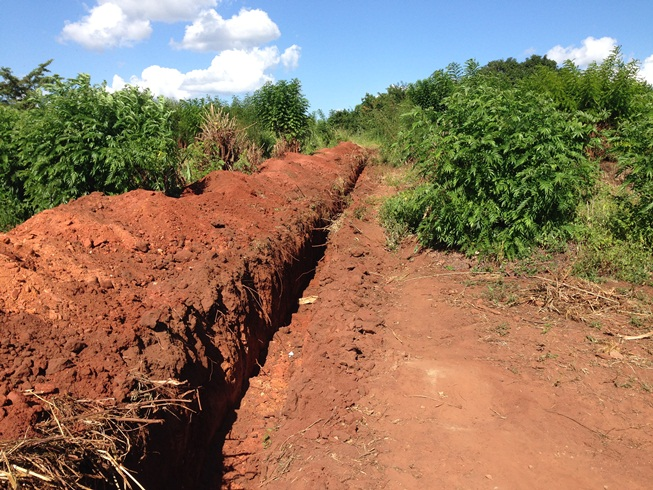 Trench dug for water line from water tower to clinic